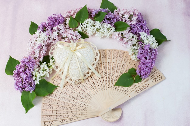 The arch of lilac, heart of lace and fan