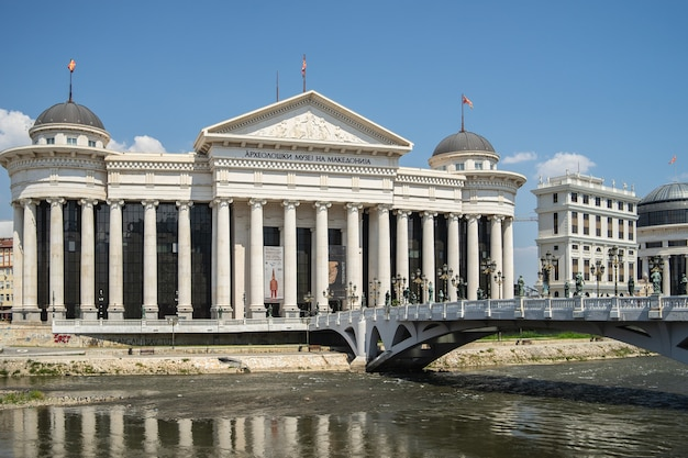 Archaeological museum of macedonia surrounded by a river with a bridge on it in north macedonia