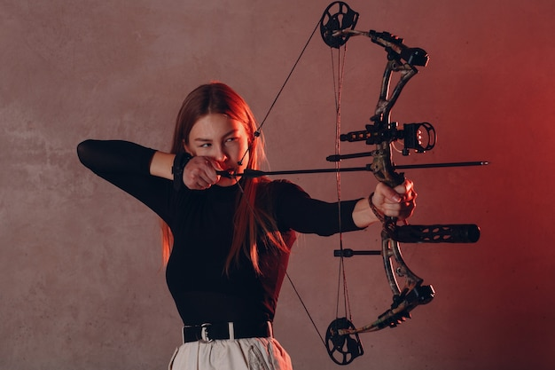 Archer woman with sport bow and arrow