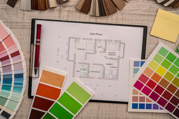 Architect construction engineer plan  with color sampler in office desk, business concept