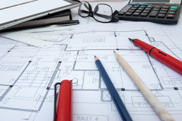 Architect design working drawing sketch plans blueprints in architect studio