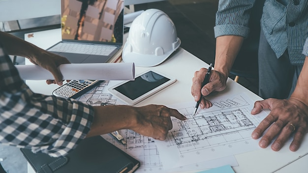 Architect engineer design working on blueprint planning concept. construction concept