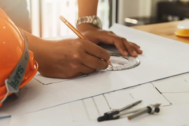 Architect or engineer working on blueprint, architectural concept