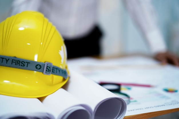Architect or engineer working project with tools in office, construction concept.
