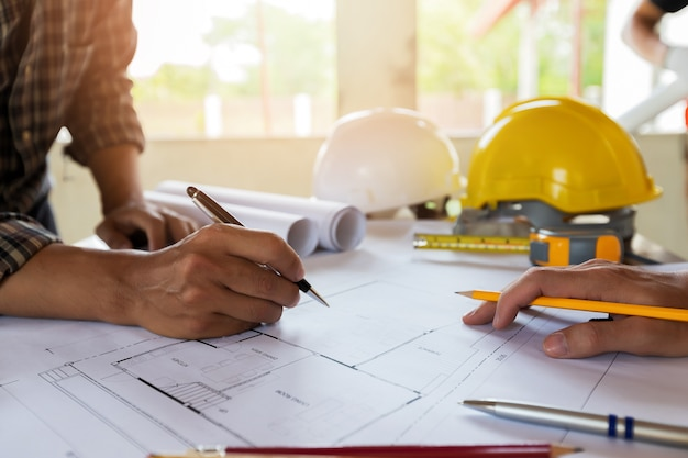 An architect or engineer writing on blueprint, architectural concept
