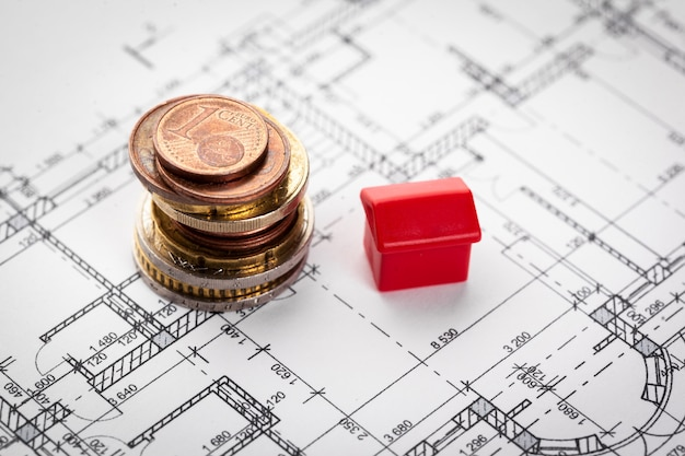 Architect house plane and coins, investment in new home concept