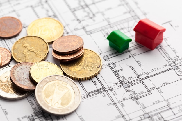 Architect house plane and coins, investment in new home