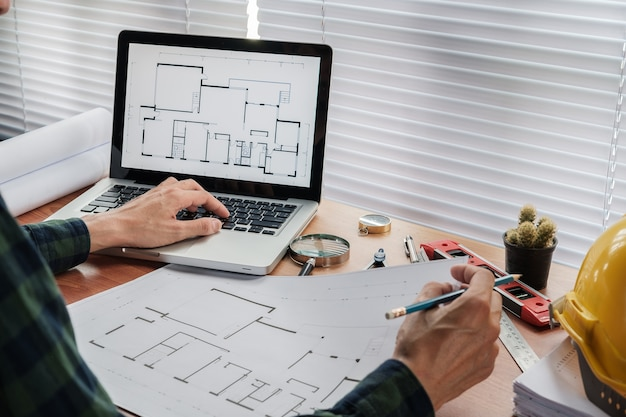 Architect man drawing on architectural project.