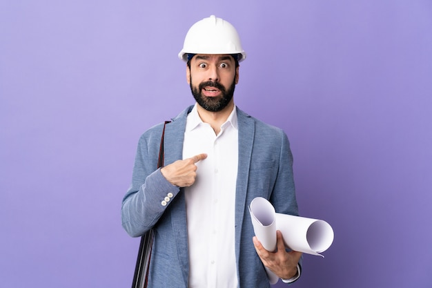 Architect man over isolated wall