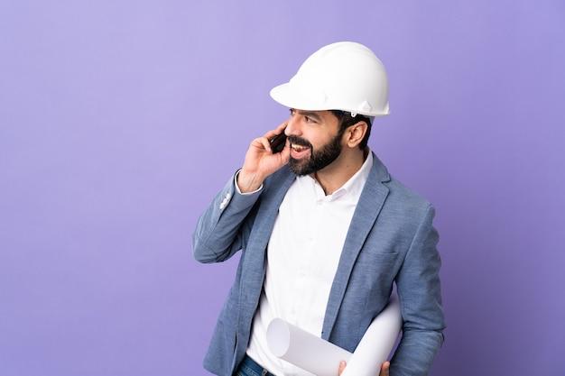 Architect man on pastel wall