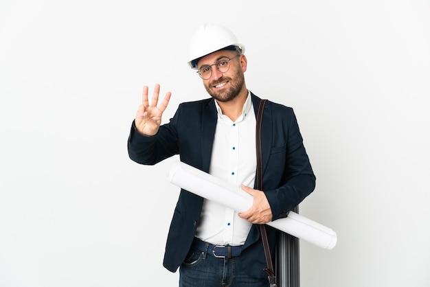 헬멧 건축가 남자와 흰색에 고립 된 청사진을 들고 행복 하 고 손가락으로 세 세