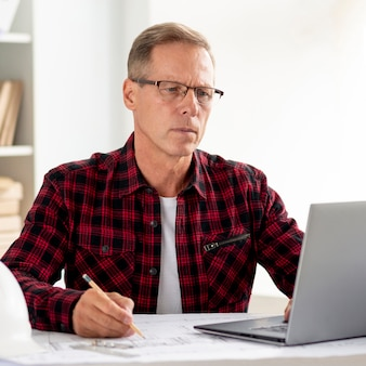 Architect searching for inspiration on laptop