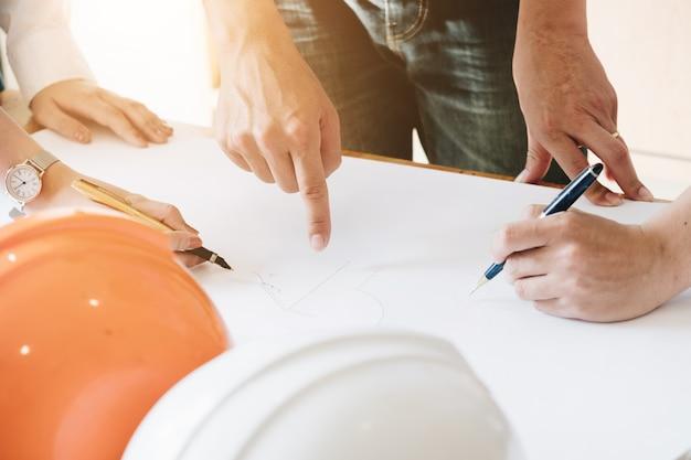 Architect team brainstorming planning design, civil engineer sketching a blueprint