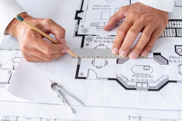 Architect using ruler on his project close-up
