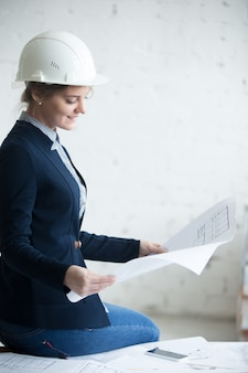 Architect woman in hardhat