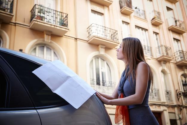 Architect woman real estate checking plan