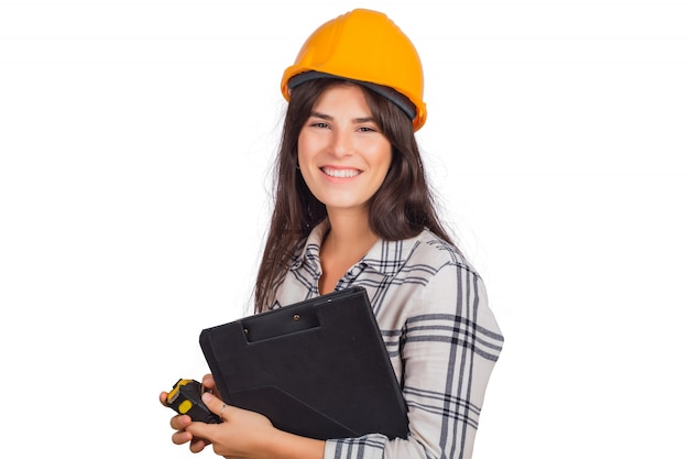Architect woman wearing construction helmet and holding folders.