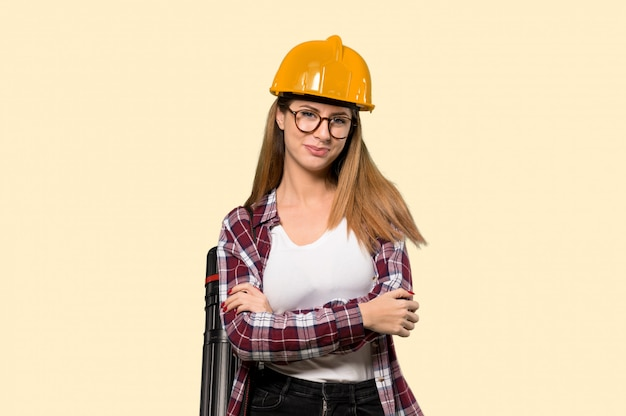 Architect woman with glasses and smiling  on yellow