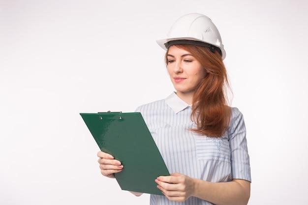 건축가, 노동자 및 부동산 개념. 여자 작성기 또는 엔지니어 화이트 문서.