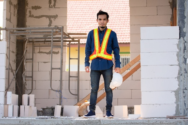 Architect worker engineer standing on site construction work building house