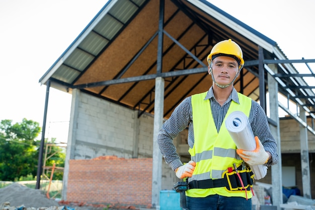 Architect working on building site