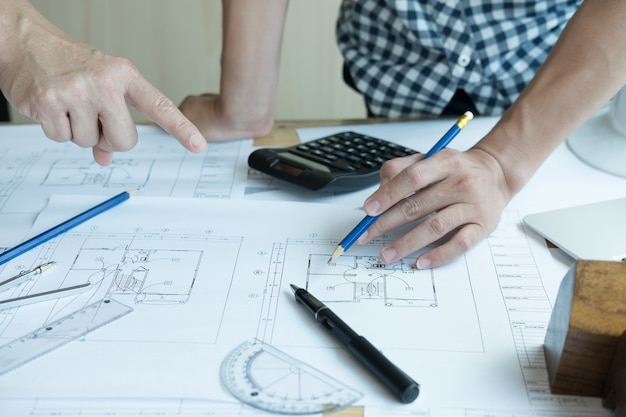 Architect working on real estate project with partner at workplace