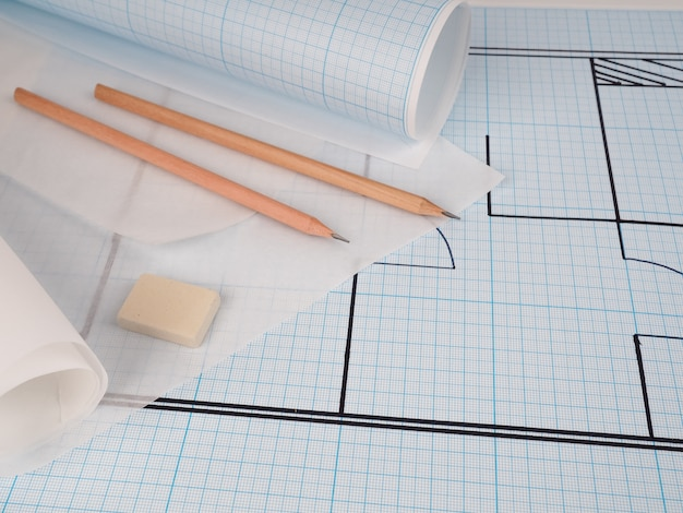 Architect workplace. architectural project, blueprints, blueprint rolls on wooden desk table.