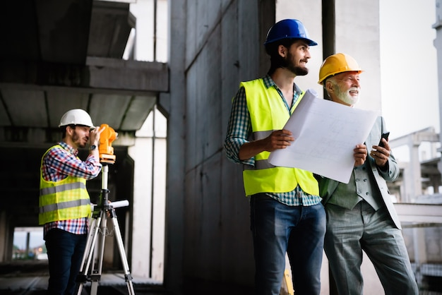 Architects and construction engineer or surveyor discussion plans and blueprints