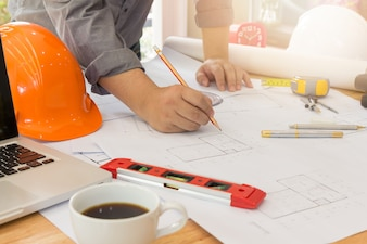 Architects office working with blueprints