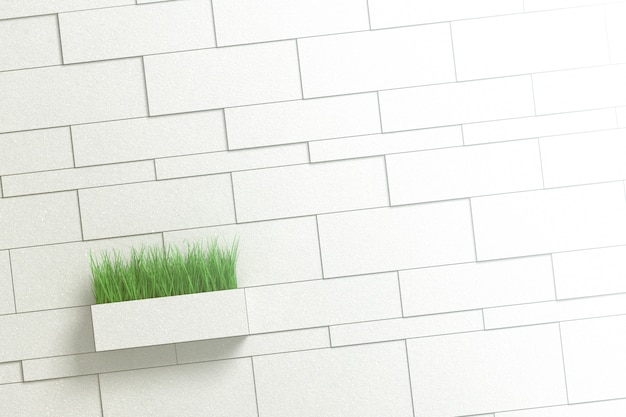 Architectural background of gray wall with different bricks and rectangular pot with grass.