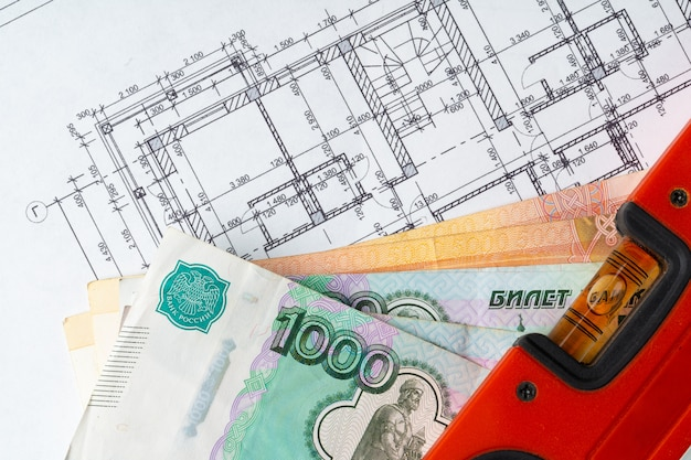 Architectural drawing and russian ruble money stack