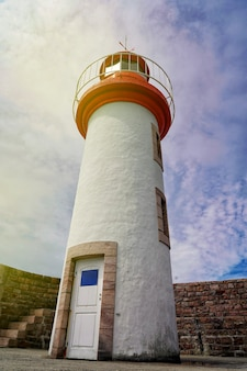 Architectural image of a lighthouse with blue sky