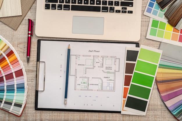 Architectural plan with color sample palette, designer working. renovation concept
