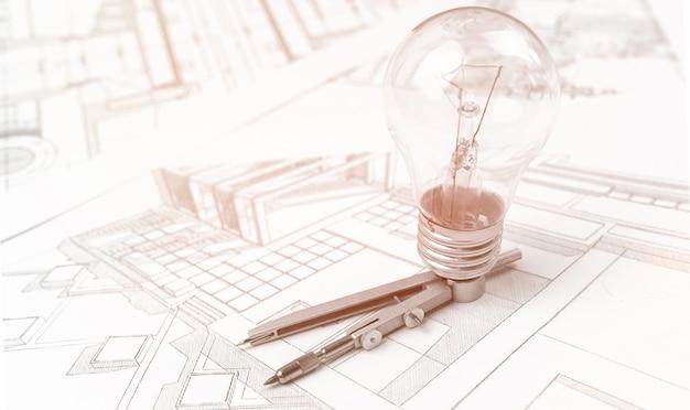 建築計画、オフィステーブルの青写真と新しいアイデアコンセプトの背景