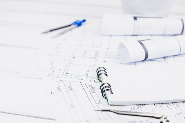 Architecture concept with notepad on plans