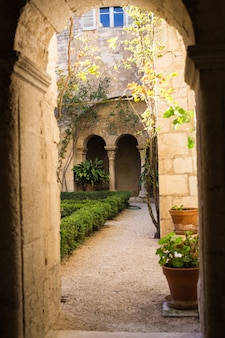 Architecture, exterior and design concept - arches of long niche leading in mediterranean courtyard or patio.