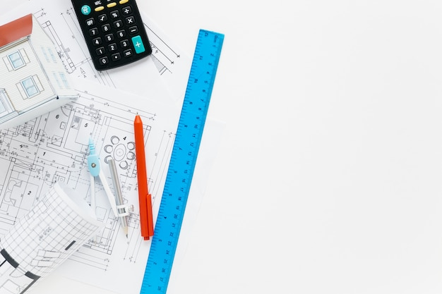 Architecture supplies with calculator on white desk