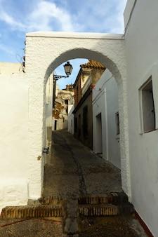 Archway at street of arcos de la frontera