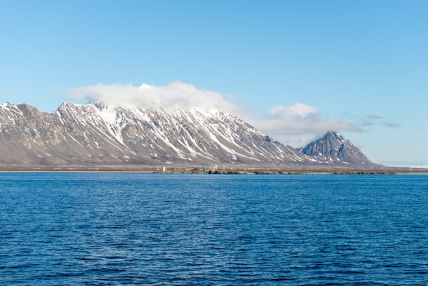Arctic landscape with mountain and clouds in svalbard in summer time