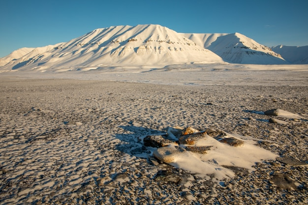 Arctic winter landscape with snow covered mountains at kapp ekholm, svalbard, norway