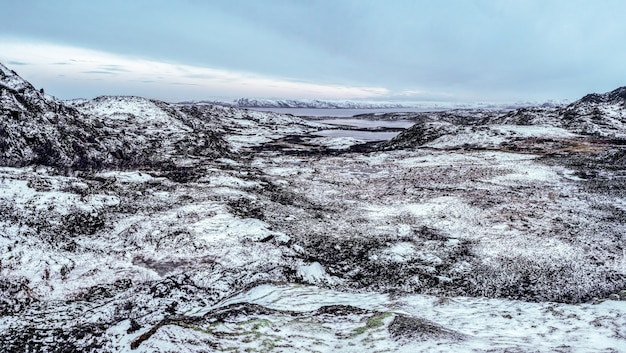 Arctic winter panoramic view of the snow-covered valley and hills on the kola peninsula. wild nature, hard-to-reach place.