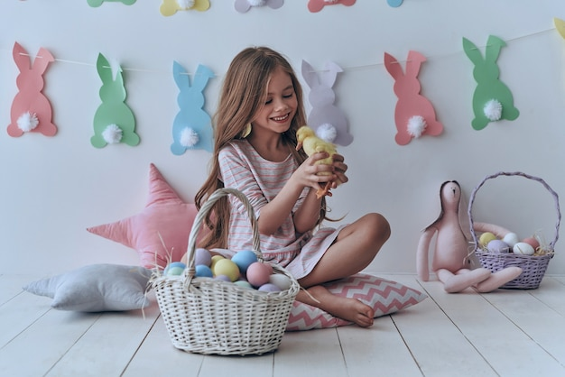Are you ready to celebrate?  cute little girl playing with a toy duck and smiling