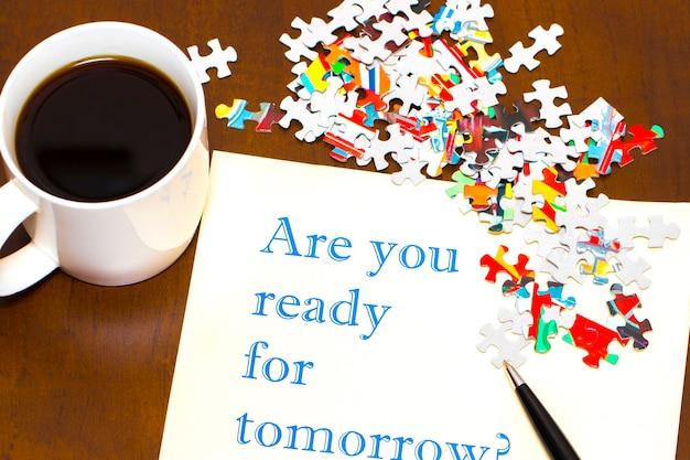 明日の質問の準備はできていますか-一杯のコーヒーと一枚の紙に手書き