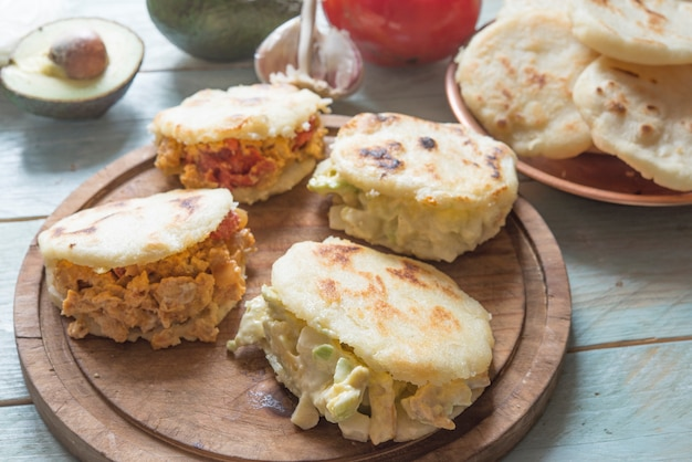Arepas with reina pepiada and egg perico