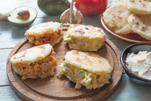Arepas with reina pepiada and egg revueltos