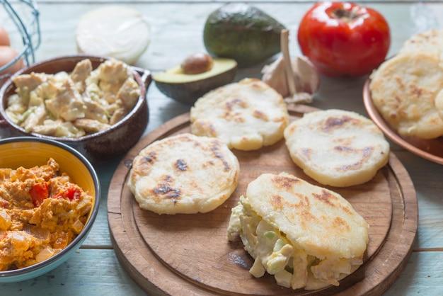 Arepas with reina pepiada and egg revueltos