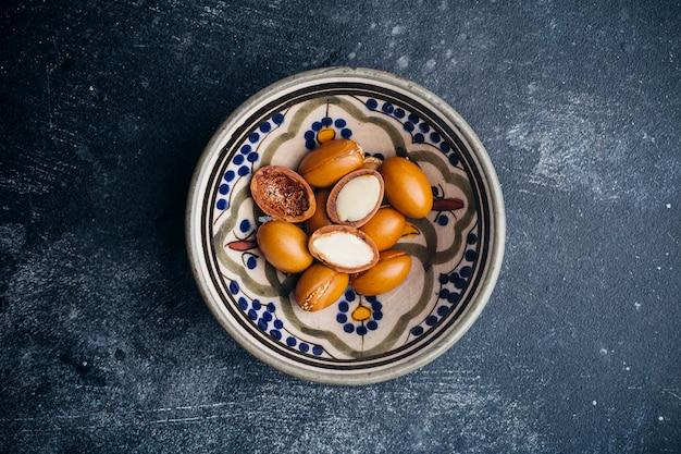 Argan seeds on a dark background