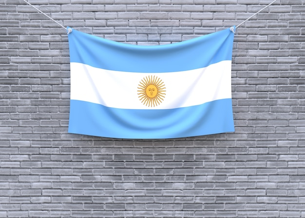 Argentina flag hanging on brick wall