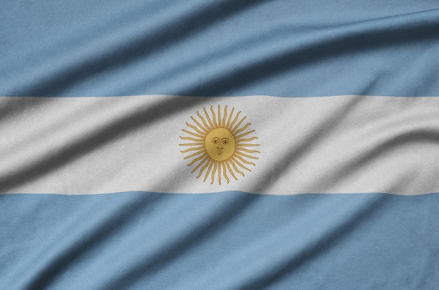 Argentina flag is depicted on a sports cloth fabric with many folds.