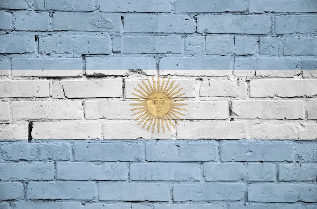 Argentina flag is painted onto an old brick wall